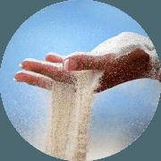 Sand slipping through fingers